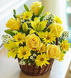 Yellow roses and yellow lilies in a Basket