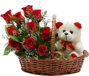 Teddy (6 inches) surrounded with 8 red roses in handle basket