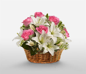 Pink roses and white lilies in a Basket