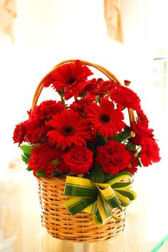 10 Red Gerberas in a Basket