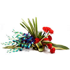 6 red Carnations and 6 Blue Orchids in a Baske